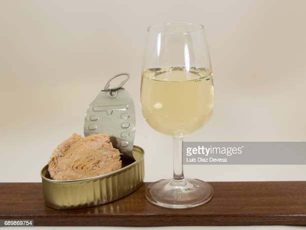 tin of tuna fishand sauce and glass of beer