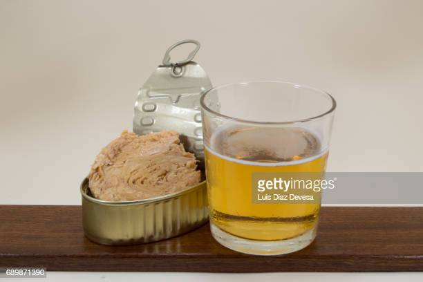 tin of tuna in olive oil and glass of beer