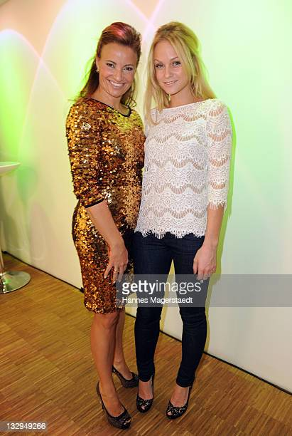 Tina Aigner and Mirjam Weichselbraun attend the Charity Night 'La Nuit Noire Doree' at the upside east on November 15 2011 in Munich Germany