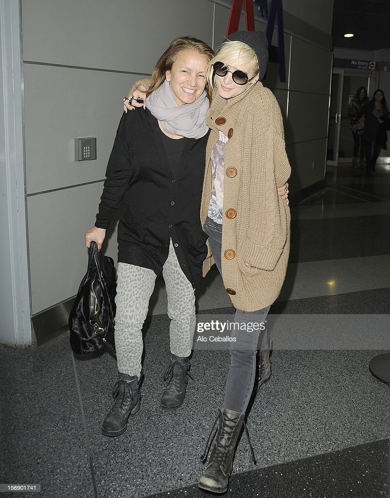 Tina Ann Drew and <a gi-track='captionPersonalityLinkClicked' href=/galleries/search?phrase=Ashlee+Simpson&family=editorial&specificpeople=201809 ng-click='$event.stopPropagation()'>Ashlee Simpson</a> are seen arriving at JFK Airport on January 2, 2013 in New York City.