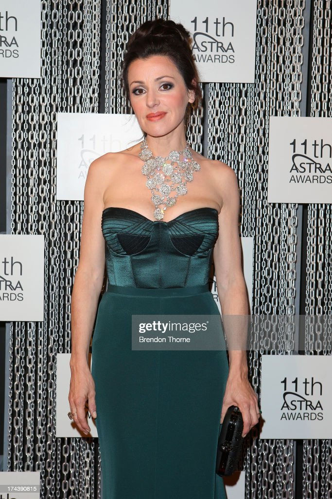 <a gi-track='captionPersonalityLinkClicked' href=/galleries/search?phrase=Tina+Arena&family=editorial&specificpeople=206470 ng-click='$event.stopPropagation()'>Tina Arena</a> arrives at the 11th Annual ASTRA Awards at The Sydney Theratre on July 25, 2013 in Sydney, Australia.