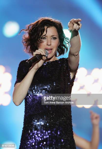 Tina Arena performs at the France 2 Television's 'Fete de la Musique' at the Auteuil Horse track on June 21 2008 in Paris France