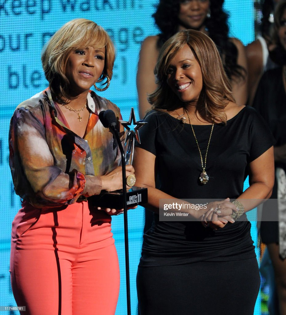 Tina Atkins-Campbell (L) and Erica Atkins-Campbell of the Gospel Group Mary Mary accept the Best Gospel award onstage during the BET Awards '11 held at the Shrine Auditorium on June 26, 2011 in Los Angeles, California.