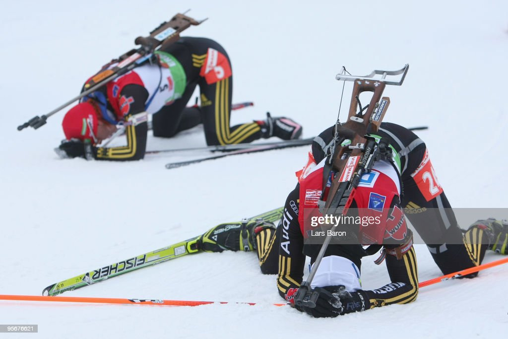 Tina Bachmann of Germany lies in the snow next to team mate Kati Wilhelm after the Women's 125 km mass start in the eon Ruhrgas IBU Biathlon World...