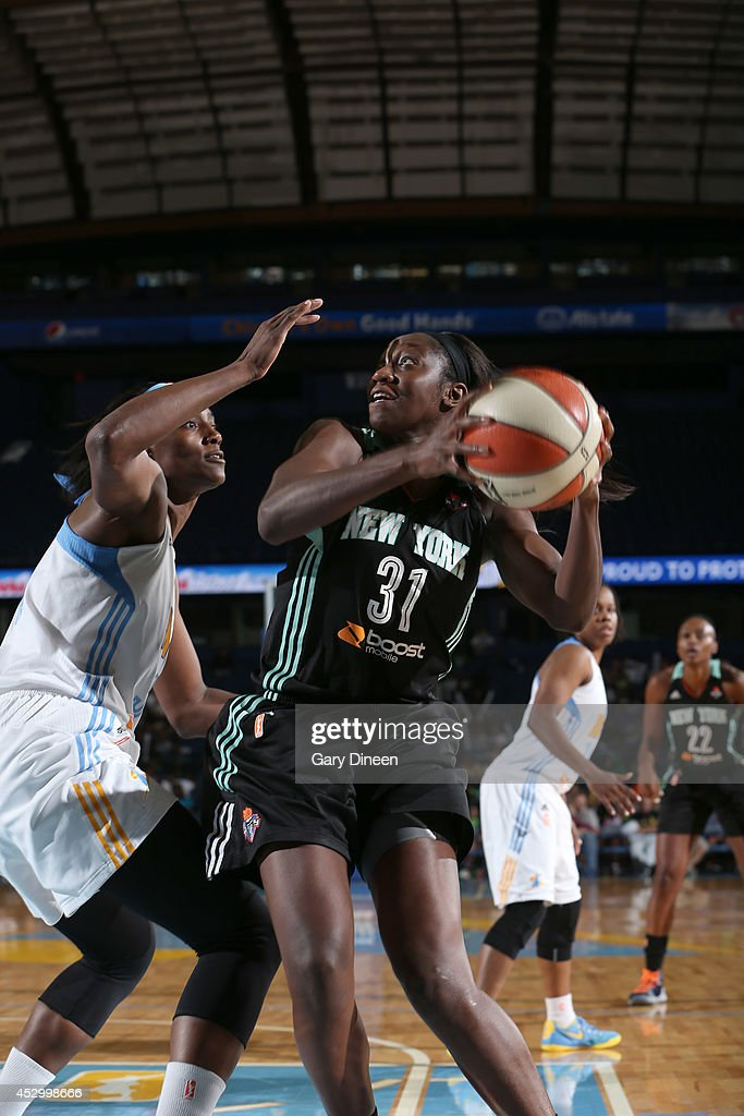 Tina Charles #31 looks to pass while defended by Sylvia Fowles #34 of the New York Liberty NAME of the Chicago Sky during the game on July 31, 2014 at Allstate Arena in Rosemont, Illinois.