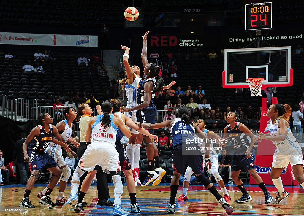 Tina Charles #31 of the Connecticut Sun jumps against Erika deSouza #14 of the Atlanta Dream at Philips Arena on July 24, 2013 in Atlanta, Georgia.