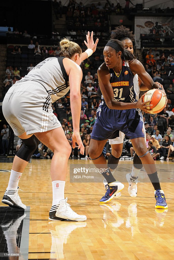 Tina Charles #31 of the Connecticut Sun makes a move against Jayne Appel #32 of the San Antonio Silver Stars at the AT&T Center on July 20, 2013 in San Antonio, Texas.