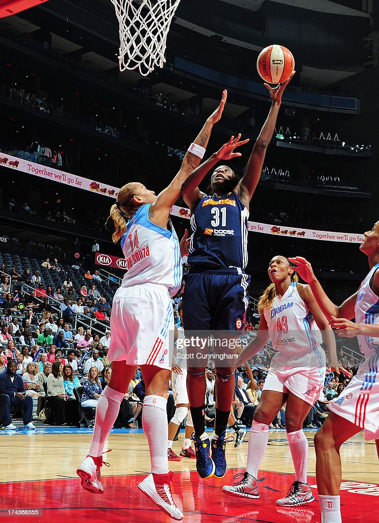Tina Charles #31 of the Connecticut Sun puts up a shot against the Atlanta Dream at Philips Arena on July 24, 2013 in Atlanta, Georgia.