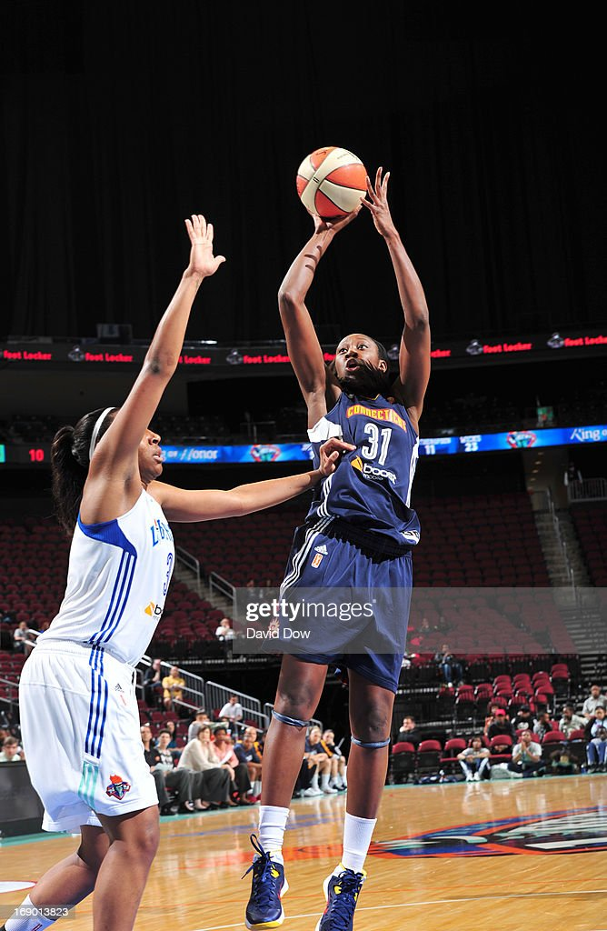 Tina Charles #31 of the Connecticut Sun shoots against <a gi-track='captionPersonalityLinkClicked' href=/galleries/search?phrase=Kelsey+Bone&family=editorial&specificpeople=5792056 ng-click='$event.stopPropagation()'>Kelsey Bone</a> #3 of the New York Liberty during the WNBA game on May 18, 2013 at the Prudential Center in Newark, New Jersey.