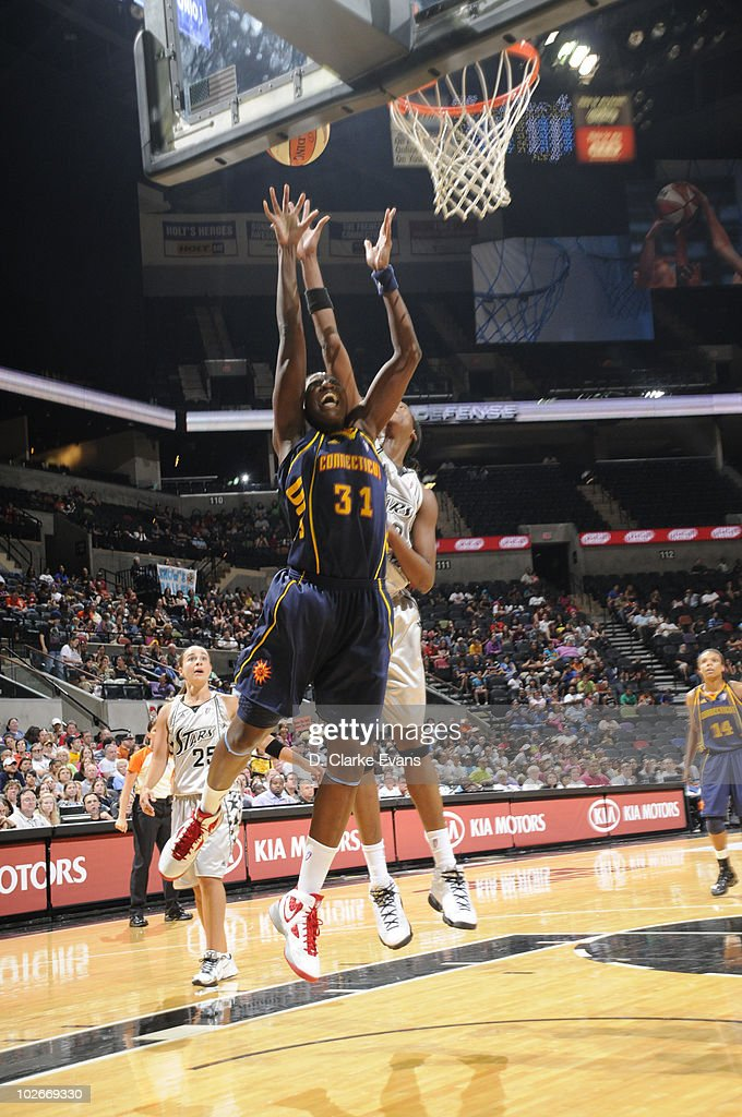 Tina Charles #31 of the Connecticut Sun shoots against <a gi-track='captionPersonalityLinkClicked' href=/galleries/search?phrase=Michelle+Snow&family=editorial&specificpeople=208195 ng-click='$event.stopPropagation()'>Michelle Snow</a> #2 of the San Antonio Silver Stars on July 6, 2010 at the AT&T Center in San Antonio, Texas.