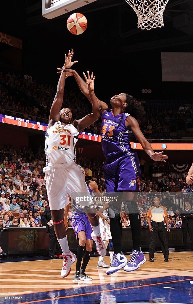 Tina Charles of the Connecticut Sun shoots against Nakia Sanford of the Phoenix Mercury on September 7 2012 at Mohegan Sun Arena in Uncasville...