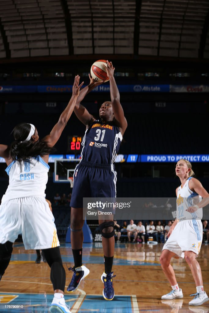 Tina Charles #31 of the Connecticut Sun shoots over <a gi-track='captionPersonalityLinkClicked' href=/galleries/search?phrase=Swin+Cash&family=editorial&specificpeople=202486 ng-click='$event.stopPropagation()'>Swin Cash</a> #8 of the Chicago Sky during the game on August 18, 2013 at the Allstate Arena in Rosemont, Illinois.