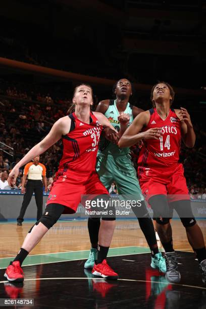 Tina Charles of the New York Liberty fights for the positon against Emma Meesseman and Tierra RuffinPratt of the Washington Mystics on July 16 2017...