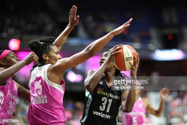 Tina Charles of the New York Liberty is blocked by Alyssa Thomas of the Connecticut Sun during the Connecticut Sun Vs New York Liberty WNBA regular...