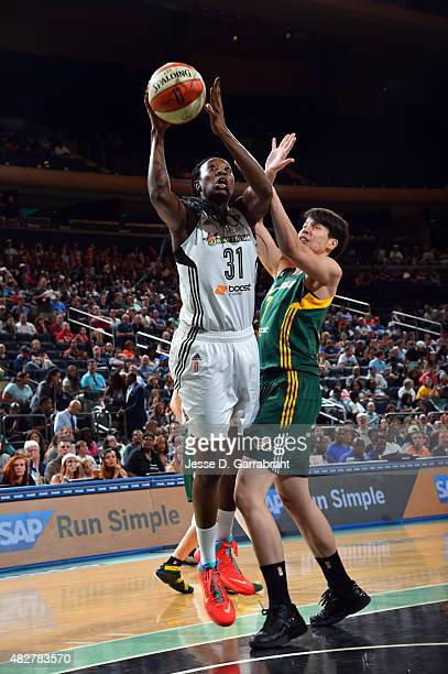 Tina Charles of the New York Liberty shoots the ball against Ramu Tokashiki of the Seattle Storm on August 2 2015 at Madison Square Garden in New...