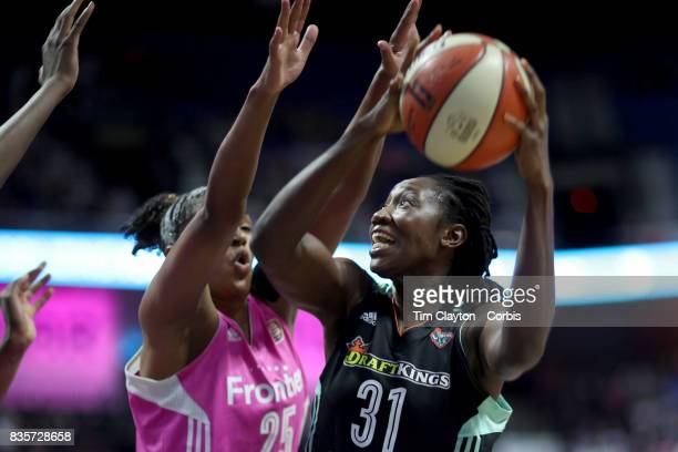 Tina Charles of the New York Liberty shoots while defended by Alyssa Thomas of the Connecticut Sun during the Connecticut Sun Vs New York Liberty...