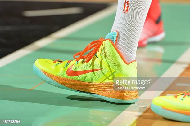 Tina Charles of the New York Liberty showcases her sneakers against the Atlanta Dream at Madison Square Garden on August 21 2015 in New York New York...
