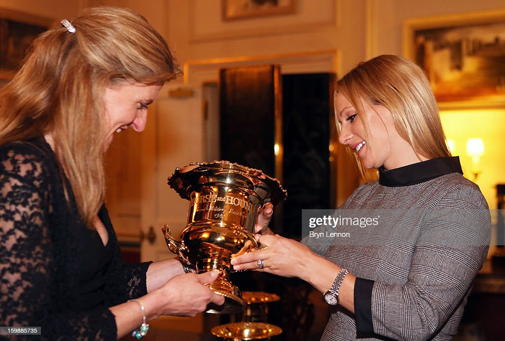 Tina Cook and <a gi-track='captionPersonalityLinkClicked' href=/galleries/search?phrase=Zara+Phillips&family=editorial&specificpeople=161323 ng-click='$event.stopPropagation()'>Zara Phillips</a> examine a trophy during a reception hosted by the Duchess of Cornwall for the British Equestrian Teams from the London 2012 Olympics And Paralympics at Clarence House on January 22, 2013 in London, England.