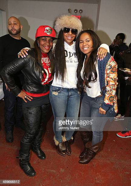 Tina Douglas Ashanti and Kenashia Douglas attend Slowbucks and Dymes Only 'Help Give Thanks' first annual food drive at the Slowbucks Compound on...