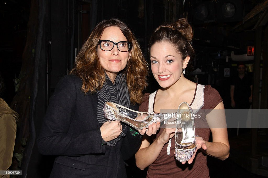 Tina Fey and Laura Osnes pose backstage at 'Cinderella' on Broadway at The Broadway Theater on October 25, 2013 in New York City.