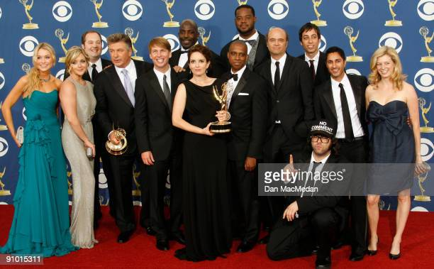 Tina Fey and the cast of '30 Rock' pose with their awards for Outstanding Comedy Series for '30 Rock' in the press room at the 61st Primetime Emmy...