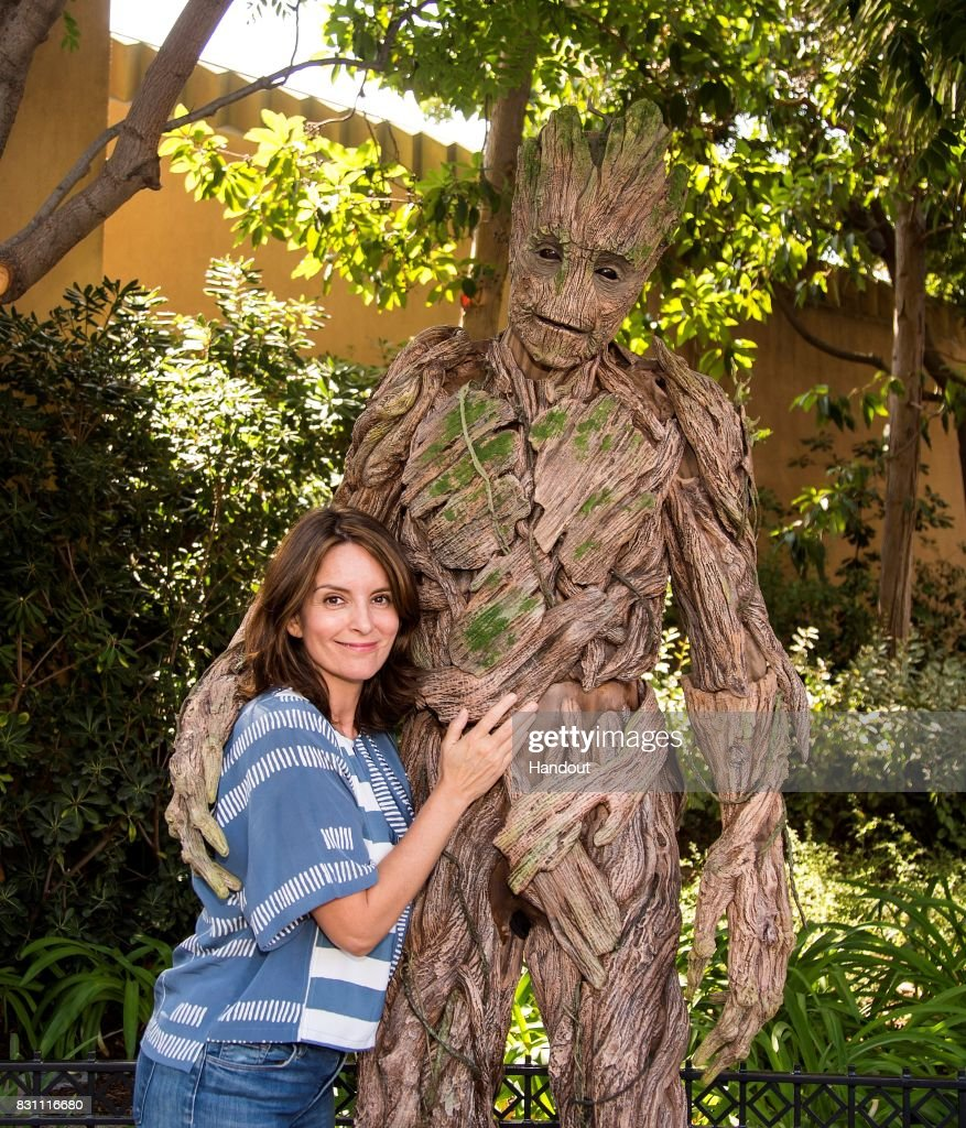 Tina Fey meets Groot of 'The Guardians of The Galaxy' outside of The Guardians of The Galaxy - Mission: Breakout attraction at Disney California Adventure on August 13, 2017 in Anaheim, California.