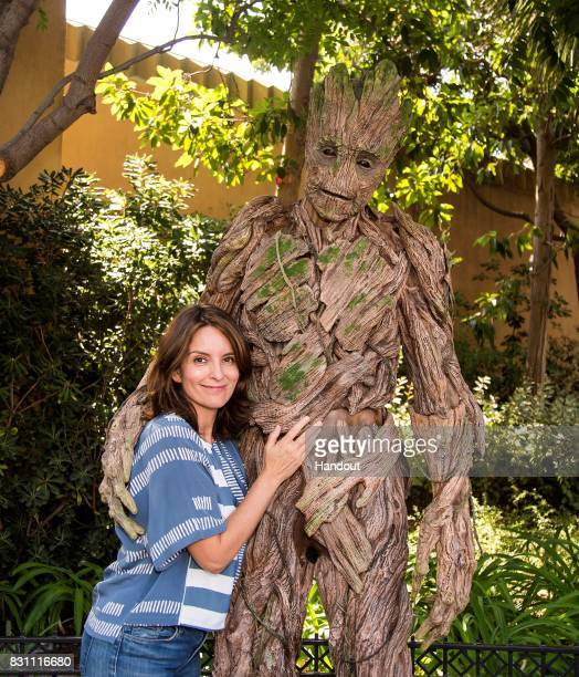 Tina Fey meets Groot of 'The Guardians of The Galaxy' outside of The Guardians of The Galaxy Mission Breakout attraction at Disney California...