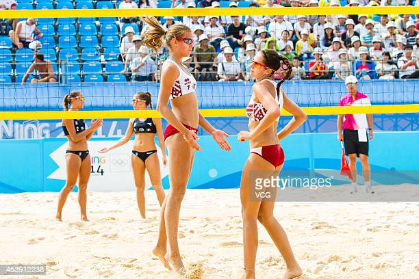 Tina Graudina and Anastasija Kravcenoka of Latvia compete with players of Italy in the Women's Beach Volleyball preliminary match on day five of the...