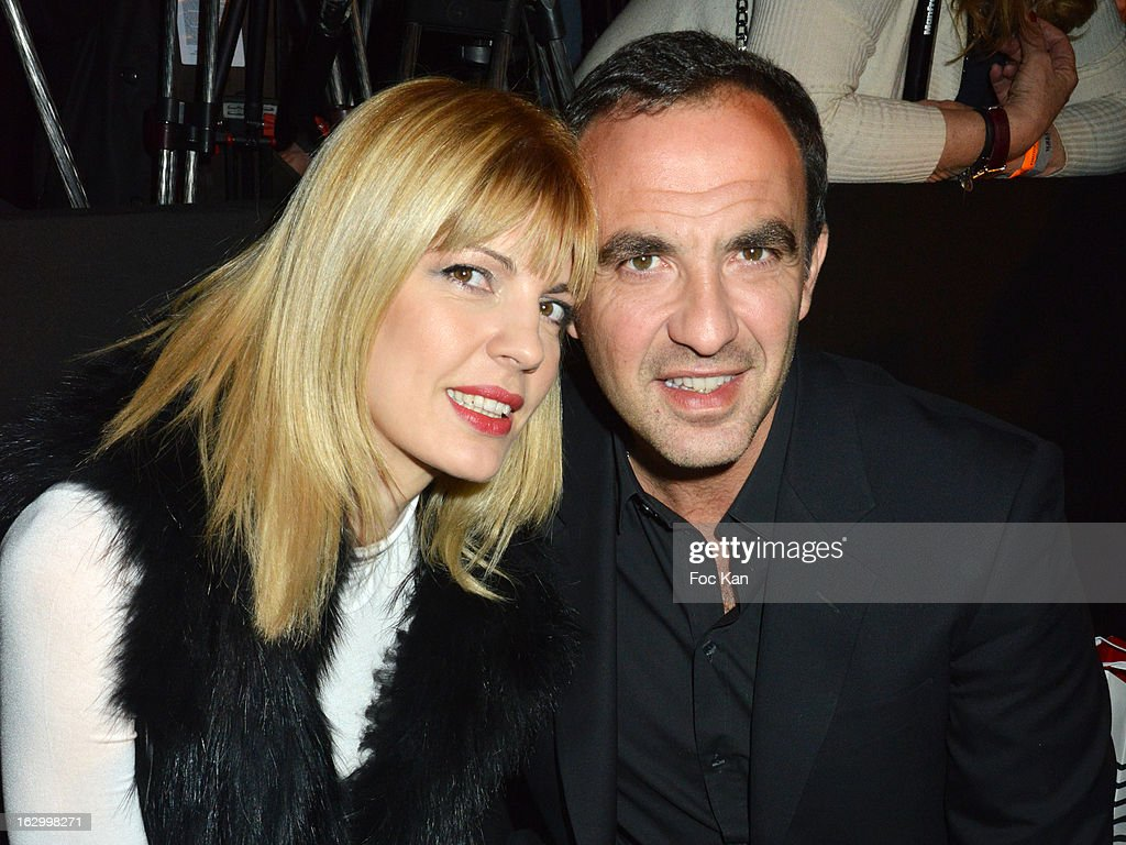 Tina Grigouriou (L) and <a gi-track='captionPersonalityLinkClicked' href=/galleries/search?phrase=Nikos+Aliagas&family=editorial&specificpeople=573643 ng-click='$event.stopPropagation()'>Nikos Aliagas</a> attend the Jean Paul Gaultier Fall/Winter 2013 Ready-to-Wear show as part of Paris Fashion Week at Sall Wagram on March 2, 2013 in Paris, France.