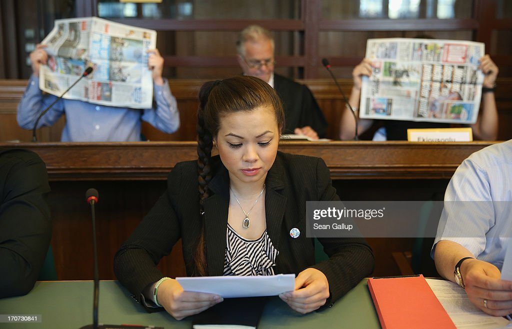 Tina K., sister of victim Jonny K., sits in the courtroom as co-defendants Bilal K. (L) and Memet E. cover their faces shortly before the continuation of the trial of the six Jonny K. attackers at the Kriminalgericht Moabit court on June 17, 2013 in Berlin, Germany. The six young men are accused of assaulting Jonny K. in front of a bar on Alexanderplatz on October 14, 2012, and beating him so severely that Jonny K. later died of his head injuries. His sister Tina has led a media campaign to draw publicity to the case and the issue of violence in German society.