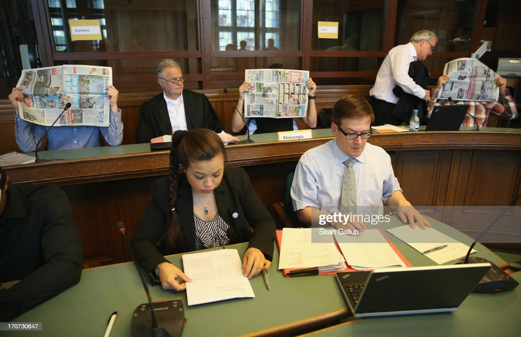 Tina K., sister of victim Jonny K., sits in the courtroom as co-defendants Bilal K. (L), Memet E. (C) and Onur U. cover their faces shortly before the continuation of the trial of the six Jonny K. attackers at the Kriminalgericht Moabit court on June 17, 2013 in Berlin, Germany. The six young men are accused of assaulting Jonny K. in front of a bar on Alexanderplatz on October 14, 2012, and beating him so severely that Jonny K. later died of his head injuries. His sister Tina has led a media campaign to draw publicity to the case and the issue of violence in German society.