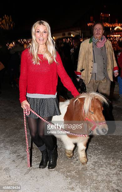 Tina Kaiser and a mini horse during the Opening of the Gut Aiderbichl Christmas Market on November 11 2014 in Henndorf am Wallersee Austria