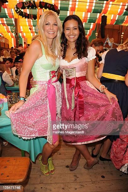 Tina Kaiser and Sinta Weisz attend the Oktoberfest beer festival at Schuetzenzelt beer tent on September 17 2011 in Munich Germany
