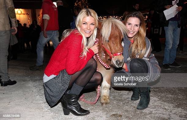 Tina Kaiser and Viola Weiss and a mini horse during the Opening of the Gut Aiderbichl Christmas Market on November 11 2014 in Henndorf am Wallersee...
