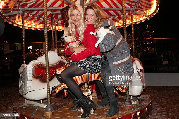 Tina Kaiser and Viola Weiss with cat and dog during the Opening of the Gut Aiderbichl Christmas Market on November 11 2014 in Henndorf am Wallersee...