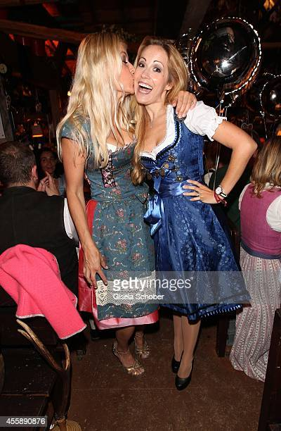 Tina Kaiser Andrea Kaiser attend the 'Almauftrieb' at Kaefer tent during Oktoberfest at Theresienwiese on September 21 2014 in Munich Germany