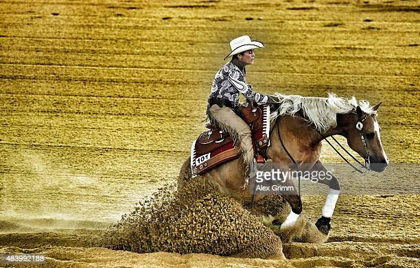 Tina KuenstnerMantl of Austria rides her horse No Chexomatic during the Reining team competition on Day 3 of the FEI European Equestrian Championship...