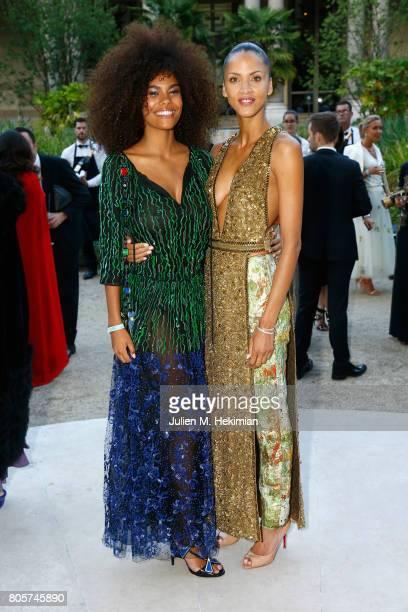 Tina Kunakey and Noemie Lenoir attend the amfAR Paris Dinner at Le Petit Palais on July 2 2017 in Paris France