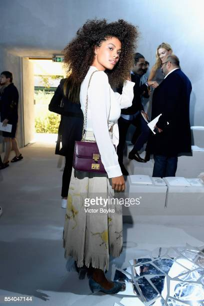 Tina Kunakey attends the Christian Dior show as part of the Paris Fashion Week Womenswear Spring/Summer 2018 on September 26 2017 in Paris France