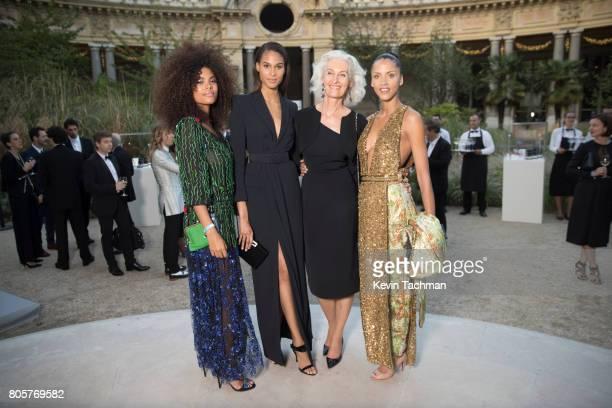 Tina Kunakey Cindy Bruna a guest and Noemie Lenoir arrive for the amfAR Paris Dinner at Le Petit Palais on July 2 2017 in Paris France