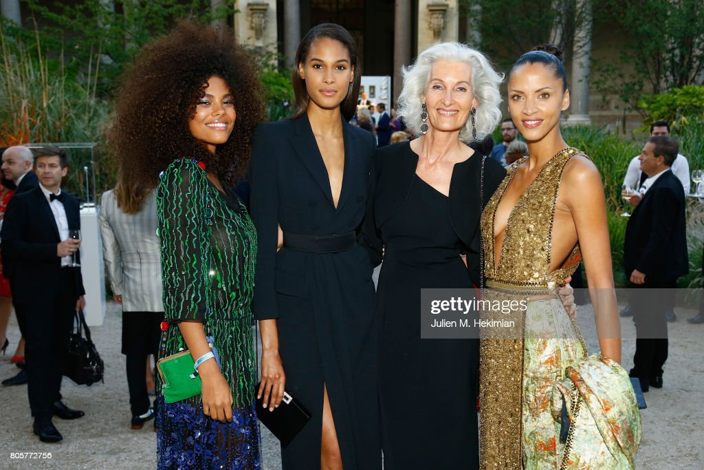 Tina Kunakey, Cindy Bruna, Catherine Loewe Noemie Lenoir attends the amfAR Paris Dinner 2017 at Le Petit Palais on July 2, 2017 in Paris, France.