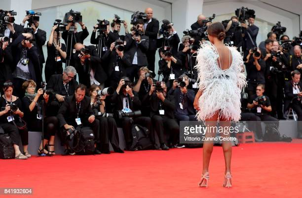 Tina Kunakey walks the red carpet ahead of the 'Suburbicon' screening during the 74th Venice Film Festival at Sala Grande on September 2 2017 in...