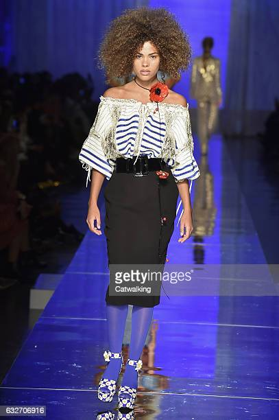 Tina Kunakey walks the runway at the Jean Paul Gaultier Spring Summer 2017 fashion show during Paris Haute Couture Fashion Week on January 25 2017 in...