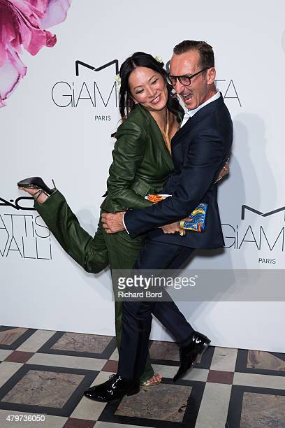 Tina Leung and Bruno Frisoni attend the MAC Cosmetics Giambattista Valli Floral Obsession Ball at Opera Garnier on July 6 2015 in Paris France