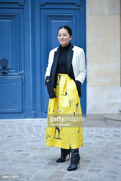 Tina Leung poses wearing a Maison Kitsune jacket and Rochas skirt before the Schiaparelli show at Place Vendome during Haute Couture on January 25...