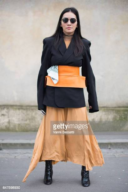 Tina Leung poses wearing a Vetements jacket and Loewe belt after the Dior show at the Musee Rodin during Paris Fashion Week Womenswear FW 17/18 on...