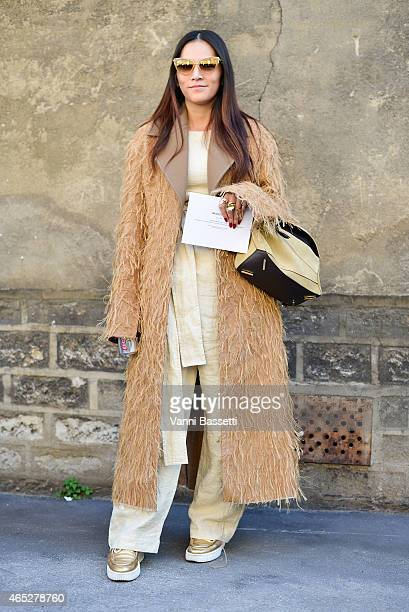 Tina Leung poses with a Loewe bag on Day 3 of Paris Fashion Week Womenswear FW15 on March 5 2015 in Paris France