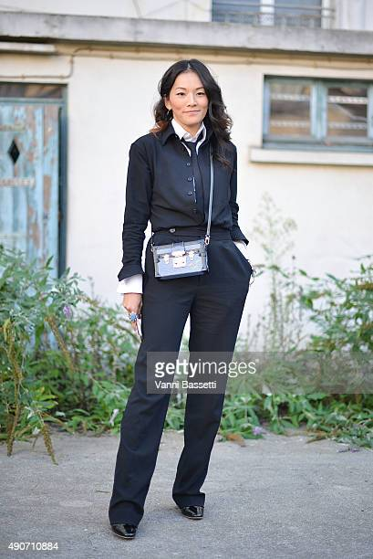 Tina Leung poses with a Louis Vuitton bag before the Dries Van Noten show during Paris Fashion Week SS16 on September 30 2015 in Paris France