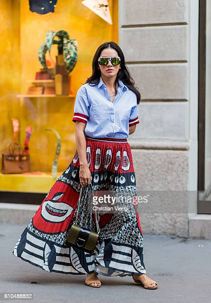 Tina Leung wearing a maxi skirt and button shirt during Milan Fashion Week Spring/Summer 2017 on September 25 2016 in Milan Italy
