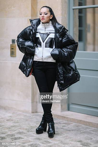 Tina Leung wears a black puffer coat at Place Vendome during Paris Fashion Week Haute Couture Spring Summer 2017 on January 24 2017 in Paris France